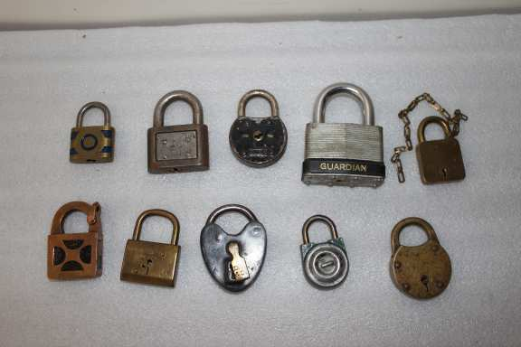 10 assorted vintage padlocks