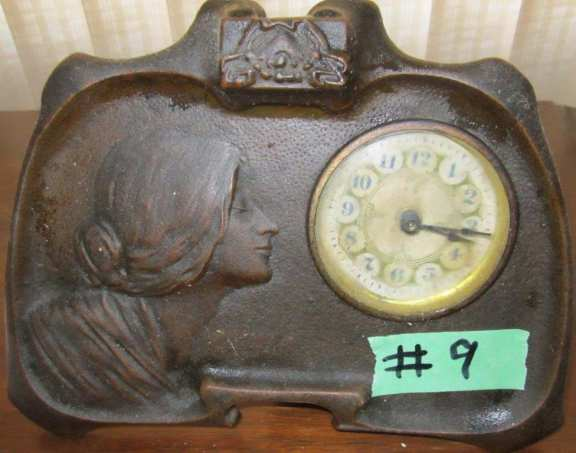 Bronze clock with picture of young lady