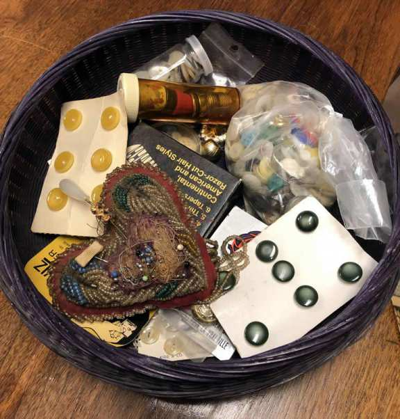 Old sewing basket with various contents