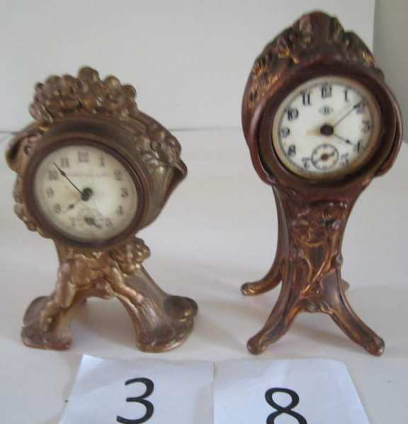 2 bronze novelty clocks
