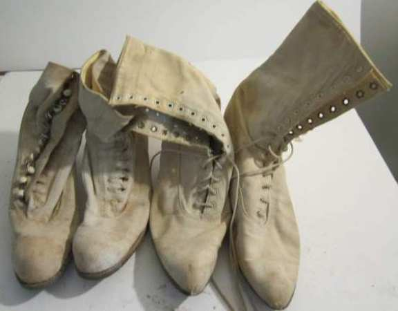 2 pair vintage high-topped shoes