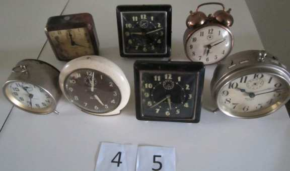7 assorted alarm clocks