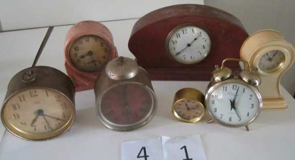 7 assorted clocks