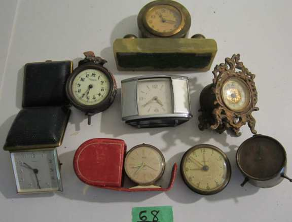 8 assorted clocks